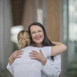 Helena hugging a patient